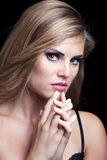 Beauty portrait of blonde girl with sparkly eye shadow Royalty Free Stock Photo