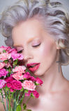 Beauty portrait of blonde pretty woman with flowers Royalty Free Stock Photo