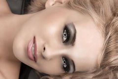 Beauty portrait of a blonde with smokey eyes Royalty Free Stock Image