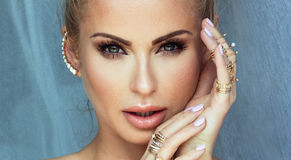 Beauty portrait of blonde woman with glamour makeup. Royalty Free Stock Images