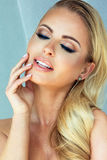 Beauty portrait of blonde woman with glamour makeup. Stock Photo