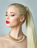 Beauty portrait of blonde woman with ponytail Royalty Free Stock Image
