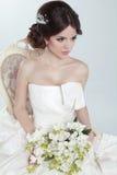 Beauty Portrait of bride wearing in wedding dress with voluminous skirt, studio photo stock photo