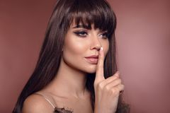 Beauty portrait of brunette woman with eyeliner makeup and long royalty free stock image