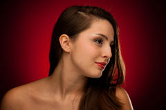 Beauty portrait of a cute caucasian woman over red background Stock Photo