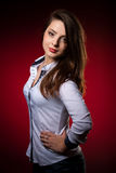 Beauty portrait of a cute caucasian woman over red background Royalty Free Stock Images