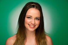 Beauty portrait of a cute teenager on green background Stock Photo