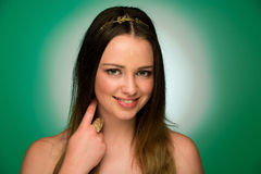 Beauty portrait of a cute teenager on green background Royalty Free Stock Photography