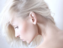 Beauty portrait of delicate blonde woman. Delicate beauty portrait of blonde attractive woman Royalty Free Stock Photography