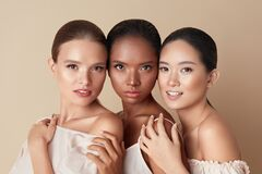 Beauty. Portrait Of Diversity Models. Mixed Race, Asian And Caucasian Girls Hugs Each Other And Looking At Camera.