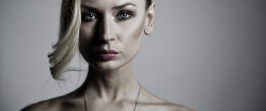 Beauty portrait of elegant blonde lady. Stock Photos