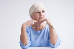 Beauty portrait of elegant senior woman. Stock Photo