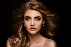 Beauty portrait of elegant woman. Beauty portrait of elegant young woman. Dark background. Girl looking at camera. Glamour makeup Royalty Free Stock Photos