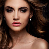 Beauty portrait of elegant woman. Beauty portrait of elegant young woman. Dark background. Girl looking at camera. Glamour makeup Royalty Free Stock Image