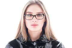 Beauty portrait of a face, in a high key. Beautiful young woman wearing glasses Royalty Free Stock Images