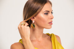 Beauty portrait of a fashion female model. Jewelry concept. Beauty portrait of a fashion female model looking away isolated on a white background Royalty Free Stock Images