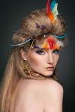 Beauty portrait in feathers Royalty Free Stock Image