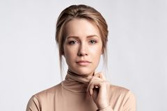 Beauty portrait of female face with professional make up. She dresses golden badloon. Stock Photos