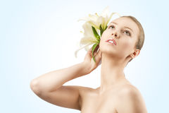 Beauty portrait with flowers, she looks up Royalty Free Stock Photos