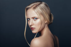 Beauty portrait of frown natural blonde woman Stock Image