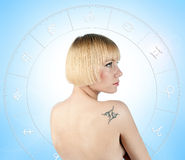 Beauty portrait with gemini tattoo. Beauty portrait of beautiful young female with gemini sign tattoo stock images