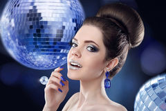 Beauty portrait of girl on disco party over ball lights night cl. Ub. Fashion woman model with colorful make-up, glitter lipstick and eyeshadows posing at camera Royalty Free Stock Images