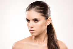 Beauty portrait of girl with nude make-up. Beauty portrait of girl with perfect nude make-up. Beauty salon. Head, eyes, hair, shoulders, studio, indoors Stock Photography