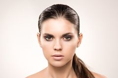 Beauty portrait of girl with nude make-up. Beauty portrait of girl with perfect nude make-up. Beauty salon. Head, eyes, hair, shoulders, studio, indoors Stock Images