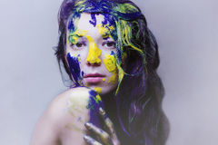 Beauty portrait of girl painted blue and yellow Royalty Free Stock Image