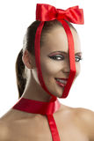Beauty portrait of girl with red bow she smiles Stock Photography