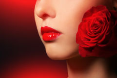 Beauty portrait of a girl with red rose Royalty Free Stock Photos