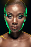 Beauty portrait of handsome ethnic african girl, on dark backgro Stock Photo