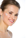 Beauty portrait of happy woman with creme on cheek Royalty Free Stock Images