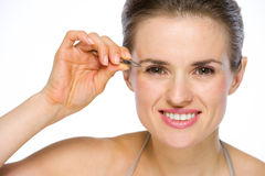 Beauty portrait of happy woman using tweezers Royalty Free Stock Photography