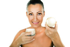 Beauty portrait of happy young woman applying creme Stock Images