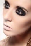 Beauty portrait of model face with fashion dark smoky-eye make-up Stock Image