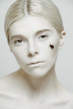 Beauty Portrait of model with insect on her face Stock Image