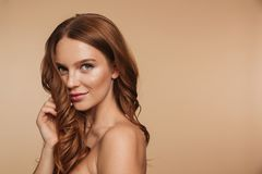 Beauty portrait of mystery smiling ginger woman with long hair stock photos