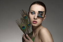 Beauty portrait with peacock feathers Royalty Free Stock Images