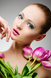 Beauty portrait with tulips Royalty Free Stock Images