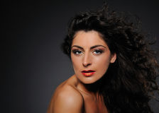 Beauty portrait of pretty woman with curly hair Royalty Free Stock Photography