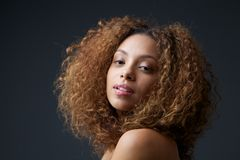 Beauty portrait of a pretty young woman with curly hair. Close up beauty portrait of a pretty young woman with curly hair Stock Photos