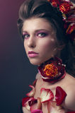Beauty portrait with red roses and petals Stock Photography