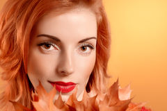 Beauty portrait redhead woman, autumn leafs,people Royalty Free Stock Images