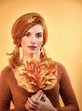 Beauty portrait redhead woman, autumn leafs,people. Beauty portrait redhead young woman with autumn leafs in hands. Attractive happy girl in autumn dream color royalty free stock image