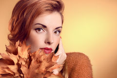 Beauty portrait redhead woman, autumn leafs,people. Beauty portrait redhead young woman with autumn leafs in hands. Attractive happy girl in autumn dream color stock photo
