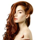 Beauty portrait of redhead woman with beautiful long hair. Over white background stock photos