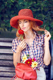 Beauty portrait redhead woman in the park, lifestyle, people. Beauty portrait of stylish playful woman with closed eyes on bench in park, people, outdoors stock photo