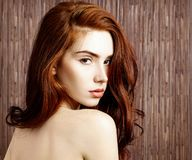 Beauty portrait of redhead woman with perfect skin. Over bamboo background royalty free stock image