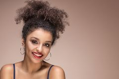 Beauty portrait of sensual afro girl. Beauty portrait of young attractive african american woman with amazing toothy smile and glamour makeup Stock Image